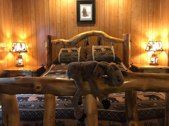 Master bedroom with Queen bed is spacious and very comfortable to sleep in. We call this room the Bears Den.