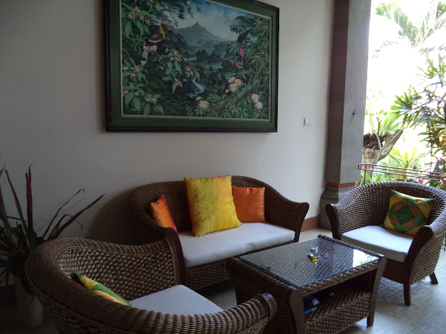 Furnished terrace overlooking tranquil gardens