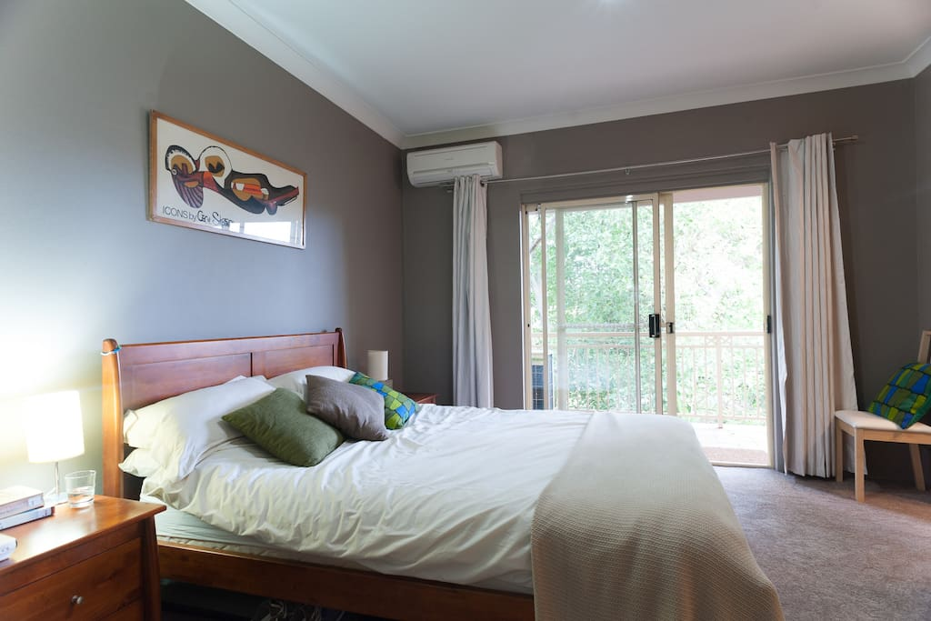 Bedroom and balcony - we've since replaced the curtains with plantation shutters