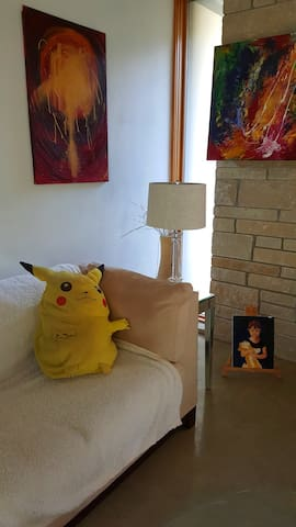 Artist and Pickachoo in living room