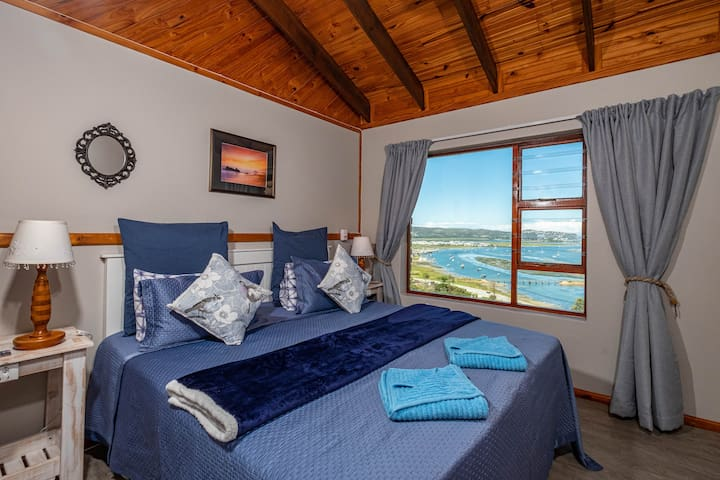 Bedroom with a  perfect view over Knysna lagoon, harbor and heads. Extra length king size bed that can be converted to two single beds on request