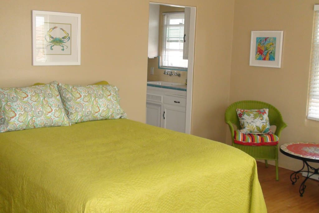 Studio features a queen size bed as well as a coffee table and chairs.