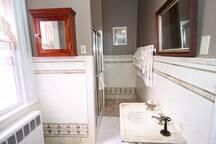 Bathroom #2-- original ornate tiles, shower