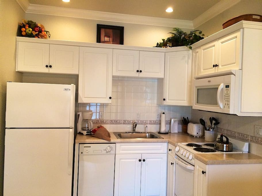 Kitchen has a stove, oven, microwave, dishwasher, microwave, fully furnished.