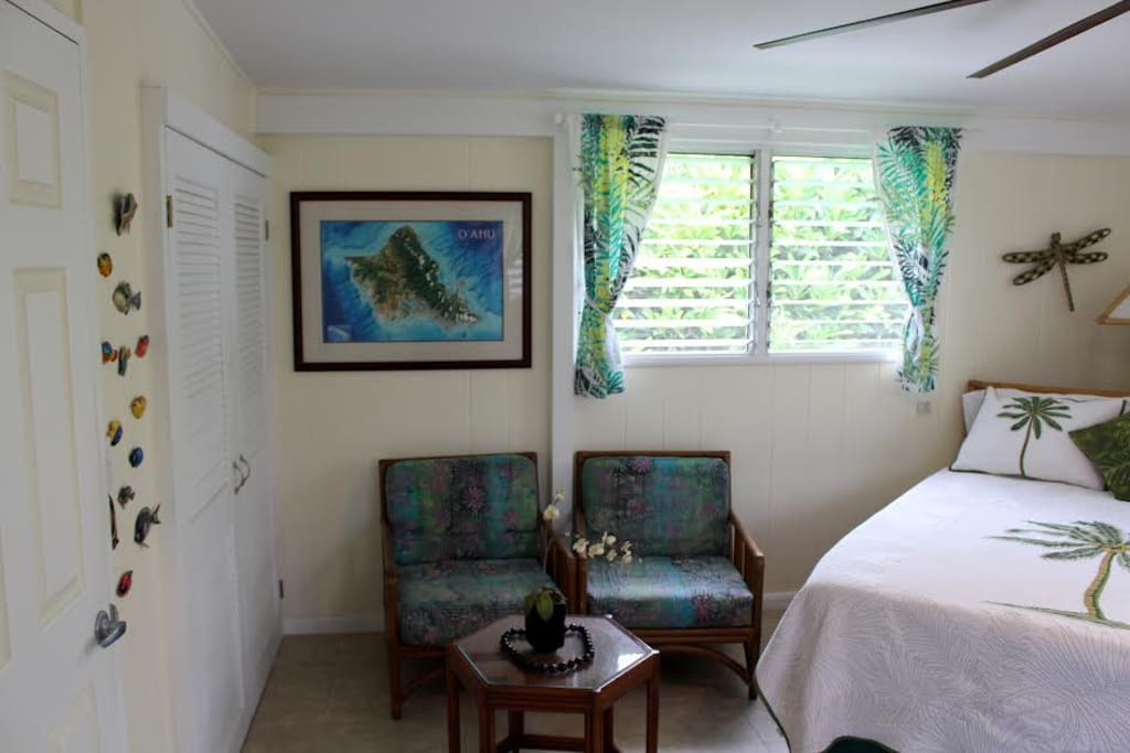 Separate seating area for relaxation, reading a book, or simply listening to the birds and geckos