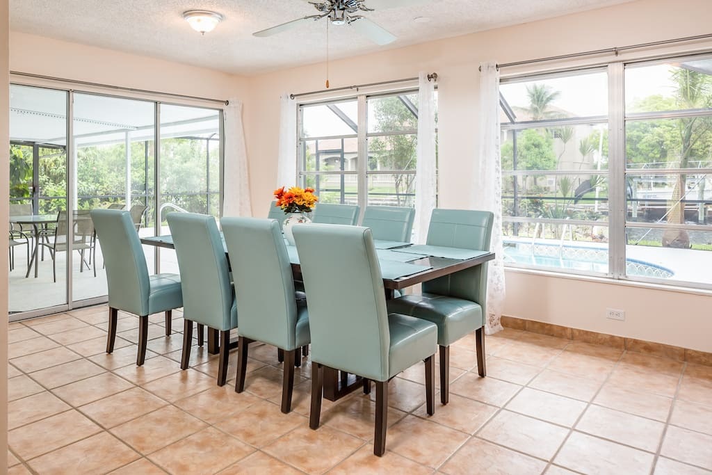 Share group meals around the dining table with 8 coastal blue chairs.