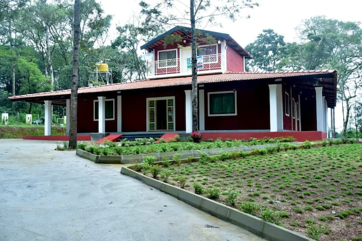 Madikeri view stay surrounded by lush green forest