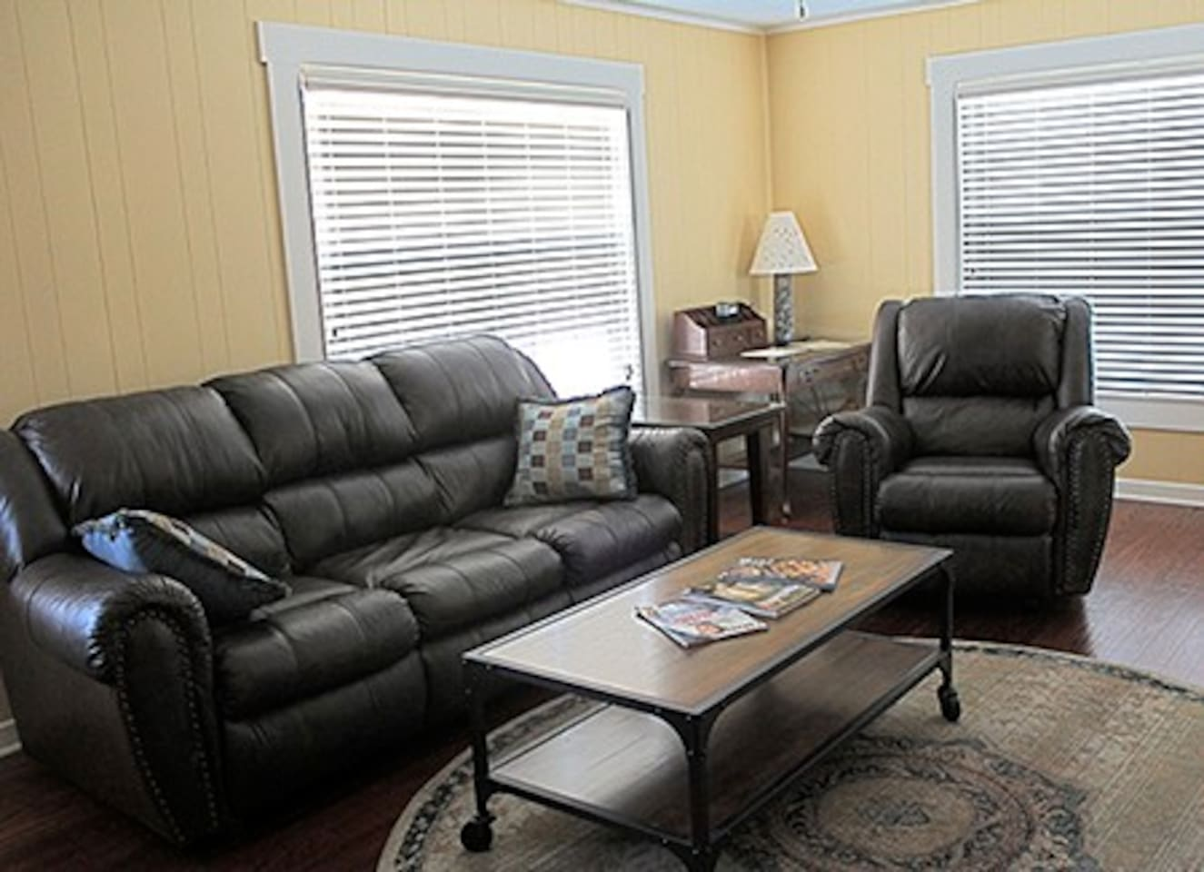 """Living Room with pull-out sofa for 2 more guests. Recliner and 43"""" TV."""