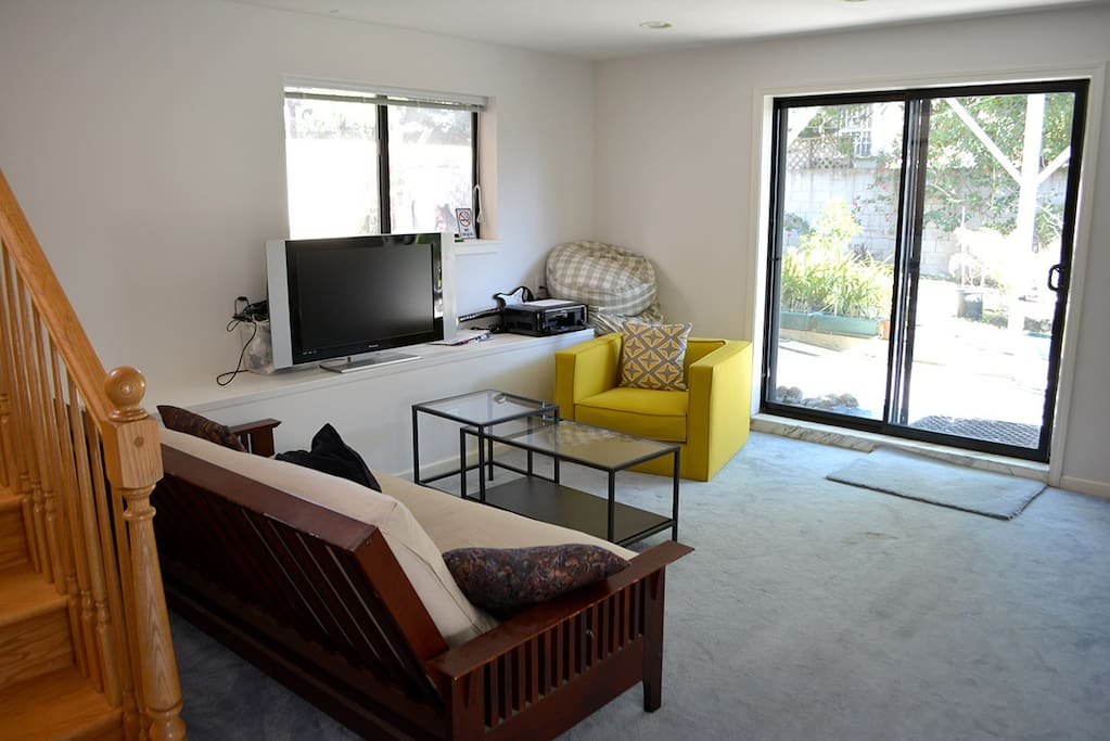 Downstairs living room area, garden view, a place to sit and read.