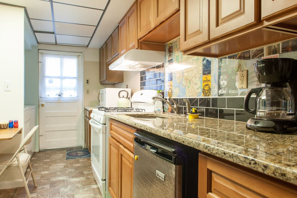 Kitchen upgraded in 2014 - new stove, counter, cabinets, waist high refrigerator & even a NYC subway map on the backsplash!