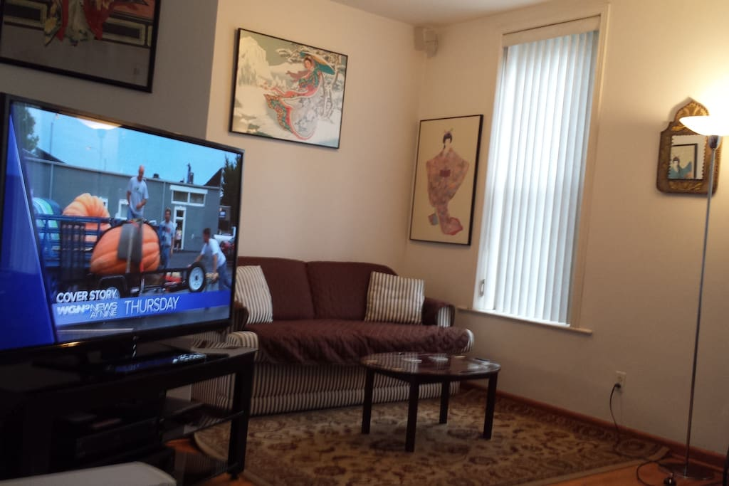 Our huge living/entertainment room.  Our tv is connected to a 7 channel surround sound receiver and Bose acoustimass speakers