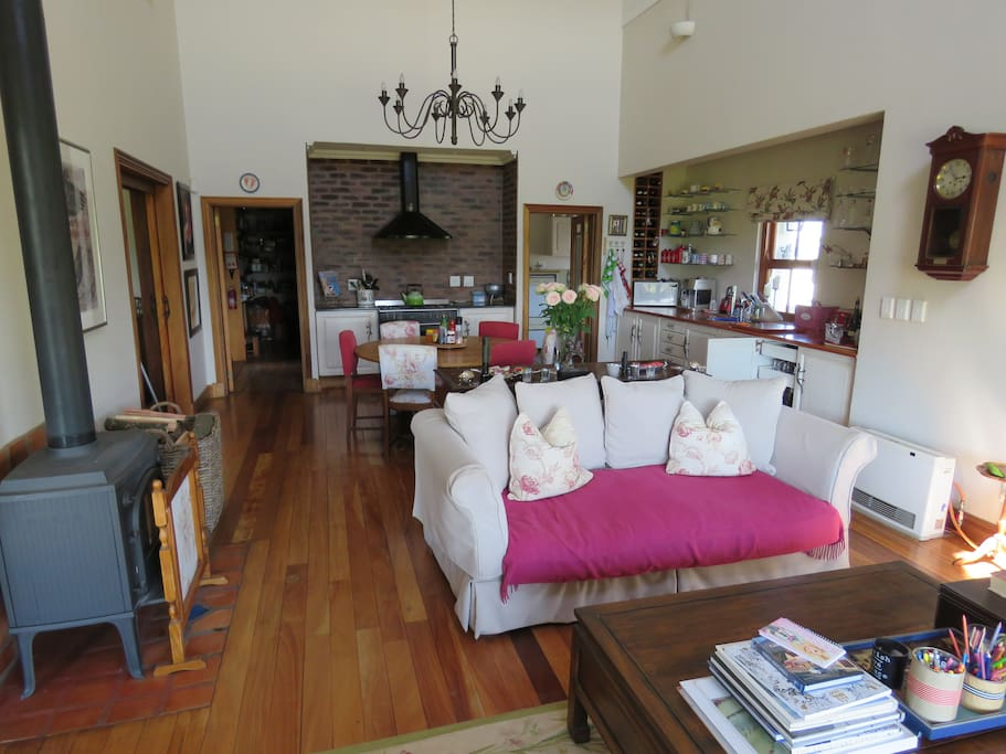The Living area, looking back to show hob, Morso fireplace and pantry.