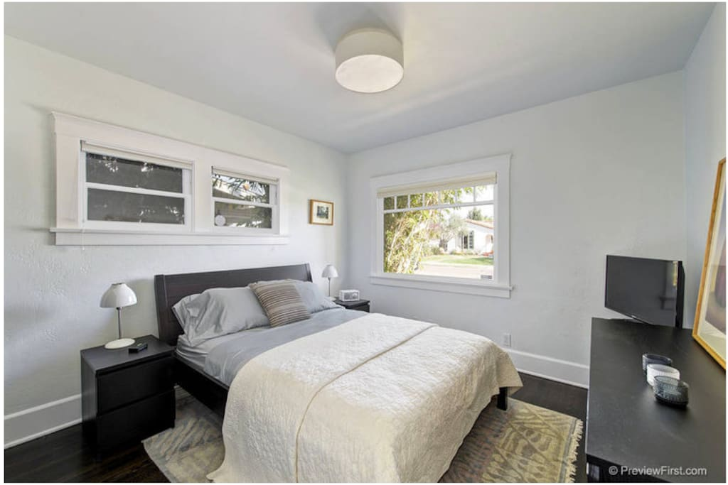 Private, queen sized bedroom is comfortable for one or two with plenty of storage and TV. Private bathroom.