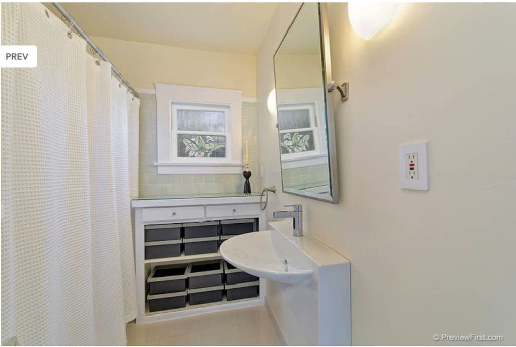 Clean, private bathroom with tub and shower.