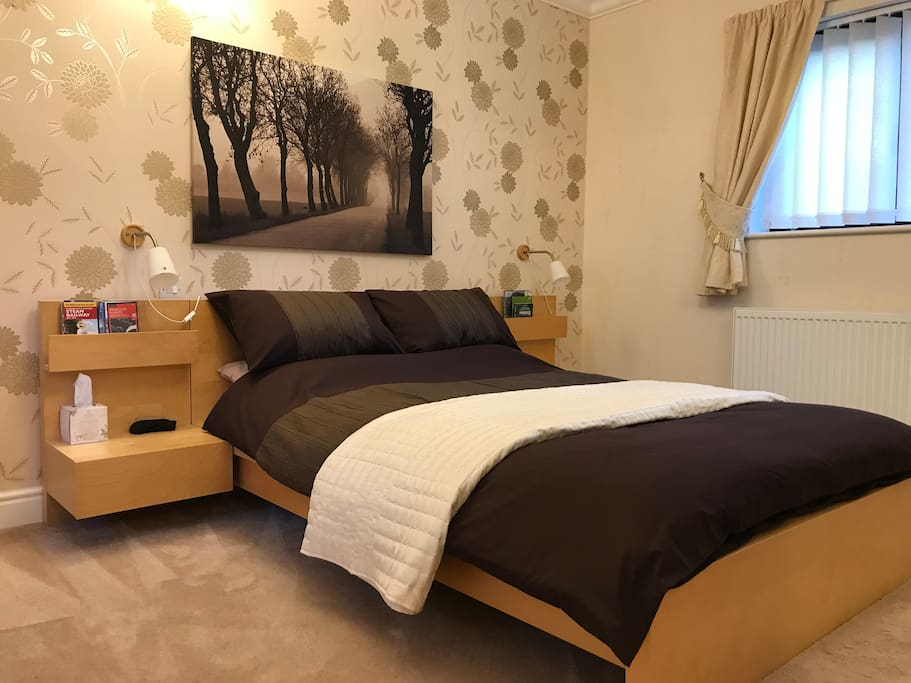 Comfortable double bed with sides and reading lamps