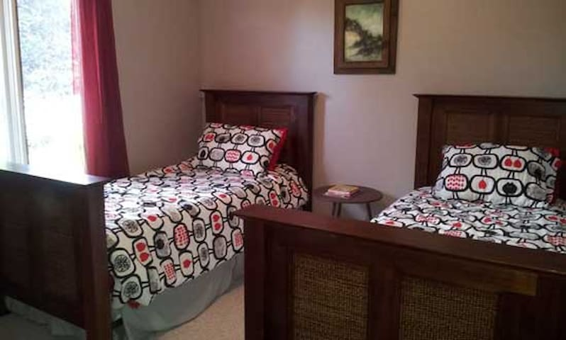 Red Maple Lodge offers two generous, bright bedrooms. One has a double bed and the other, two singles perfect for kids.