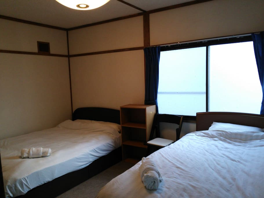 This bedroom has 1 semi double bed and 1 single bed.