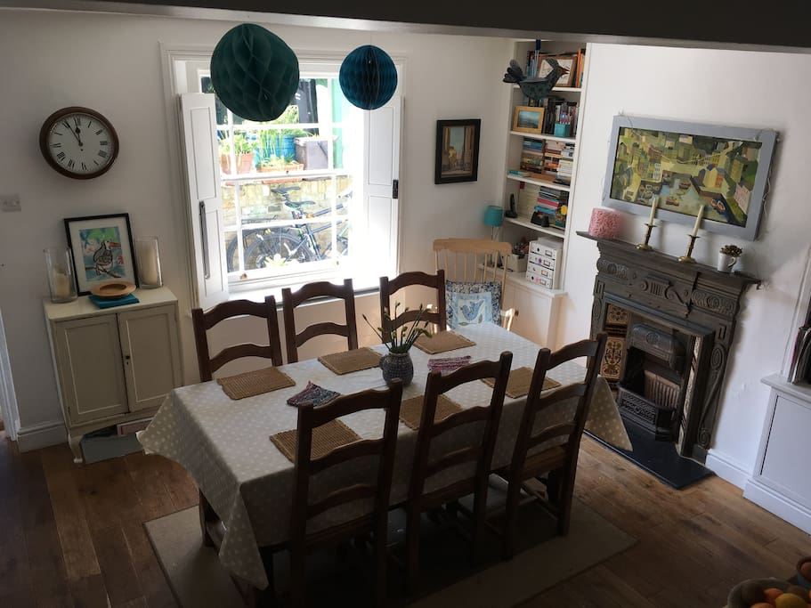 Sun-filled kitchen. Table for 6-8 people.