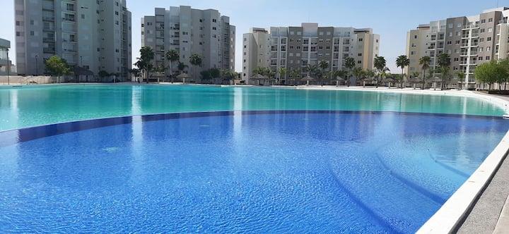 Acogedora casa con laguna artificial y albercas