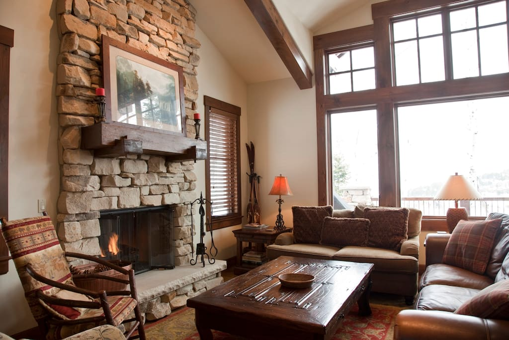 Large Great room with vaulted ceilings, fireplace, and 20 mile view!