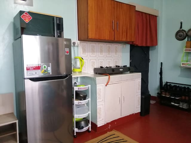LG Double door fridge to keep all your foodstuffs cool. Microwave grill and hot water kettle available. Cooking utensils also available with a 2 burners gas-cooker. Large Cupboard for storage.