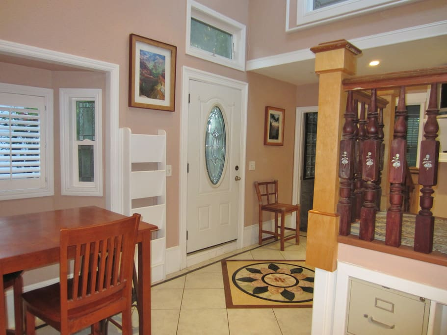 Artistic touches on the walls, door, floor and staircase