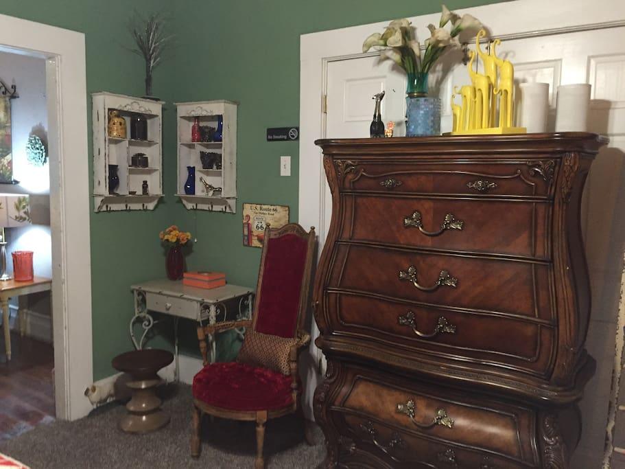 Dresser and desk in bedroom