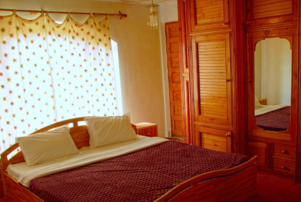 Premium room in Hillscape Inn. The room is a master bedroom sizing 180 sq feet