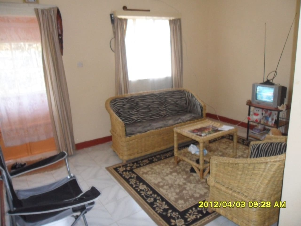 my humble and pretty living room with animal print (zebra) couch covers