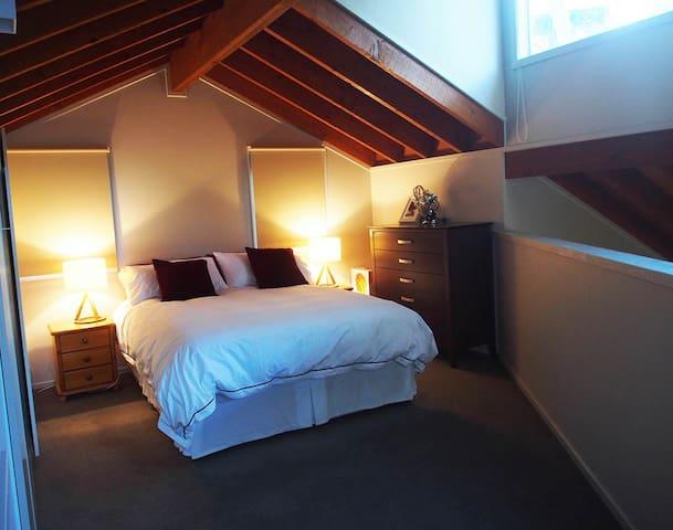 Queen bed on a mezzanine