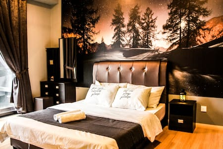 Bedroom with queen size bed, dressing table and closet