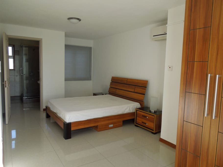 Master Bedroom with a balcony, bathroom, double bed and aircon