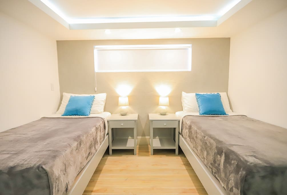 2 Single Beds await you in the upstairs Ocean View Loft- We provide top of the line linens and bedding to ensure a wonderful night's rest!
