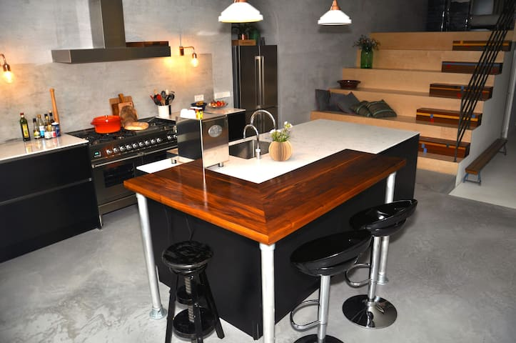 Large kitchen with bar to have a coffee or breakfast