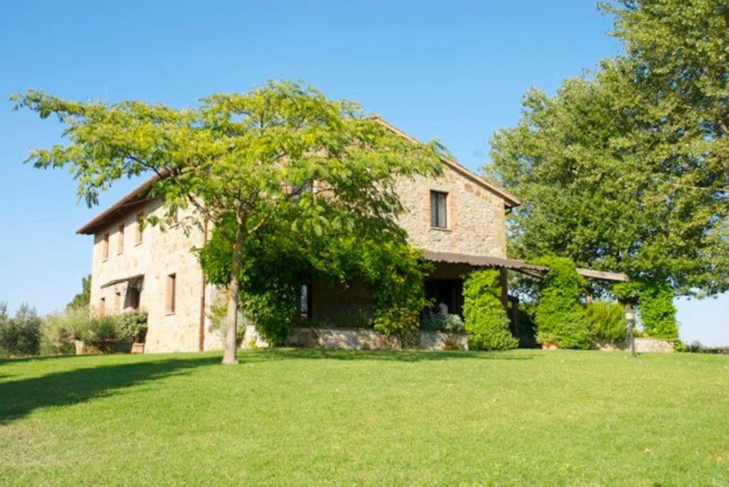 Umbrian farmhouse with terrace overlooking the pool.