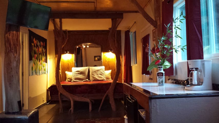 Room 6 at Aloha Crater Lodge, The Orchid Suite with custom king sized pole bed, private bath with double head shower, kitchenette with daily in room continental style breakfast.