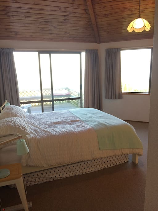 Master bedroom with private deck and sea view
