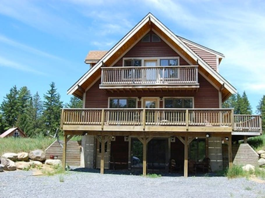 Cedar siding, deck, balcony on the top floor, 2500 square foot. Miles of hiking trails around.