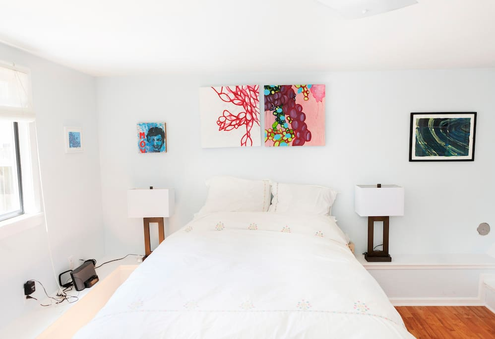 Queen-sized bed, plenty of closet space, and art by our (very) local artist!