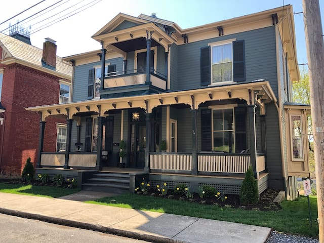 Our beautiful, historic Victorian Home with it's sprawling front porch.