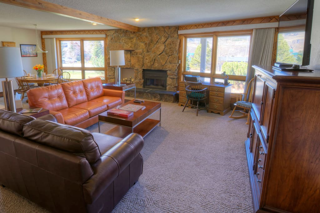 Our cozy first-floor living room, complete with a working fireplace and breathtaking mountain views!
