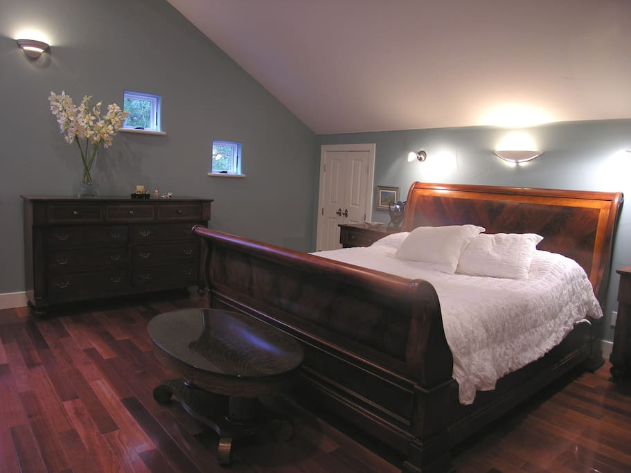 Large master bedroom with a comfortable king bed to slumber.