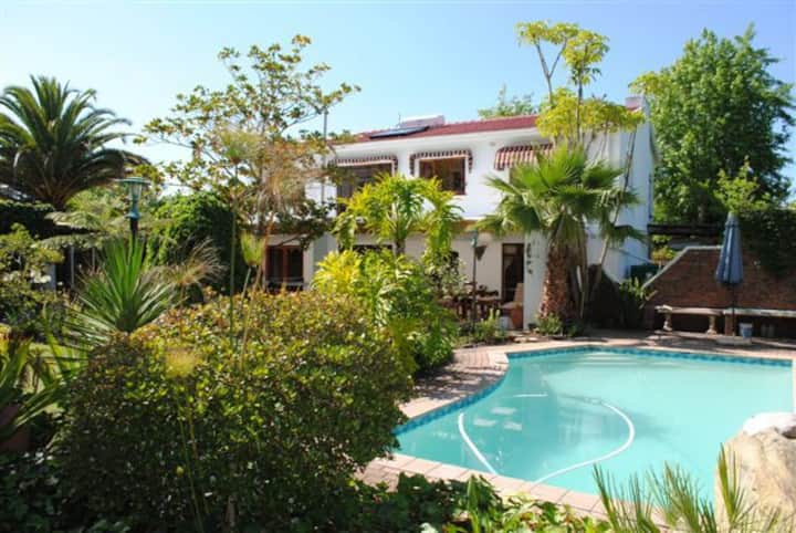 Room with 2 single beds ; private bathroom; pool