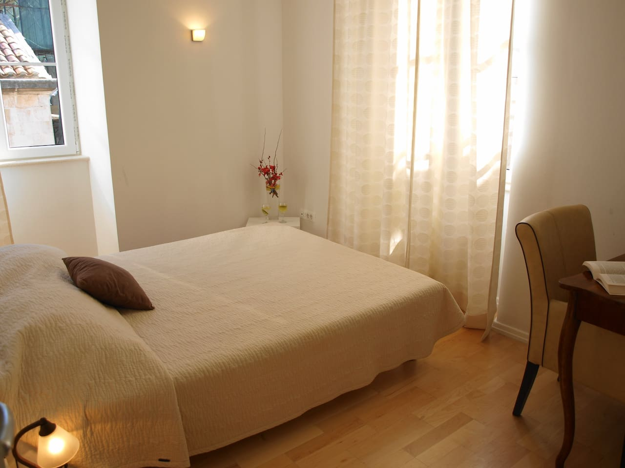 Welcome to Secret IV Apartment in the heart of Dubrovnik Old Town! The main bedroom with large windows to full the room with sunlight