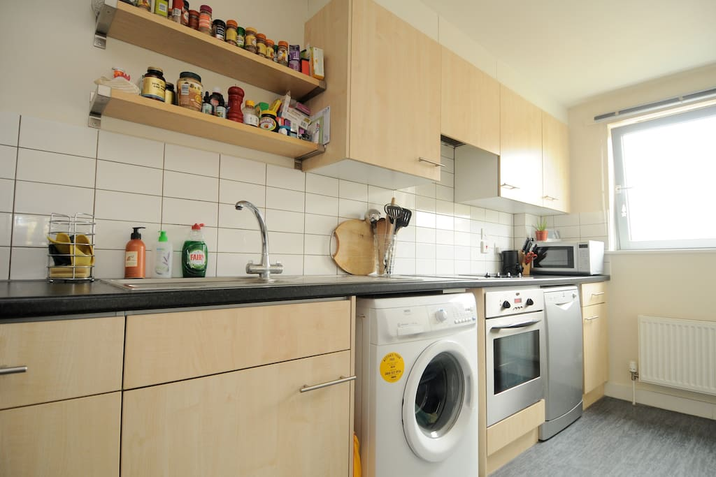 Kitchen with all mod cons, including washing machine, dishwasher and microwave.