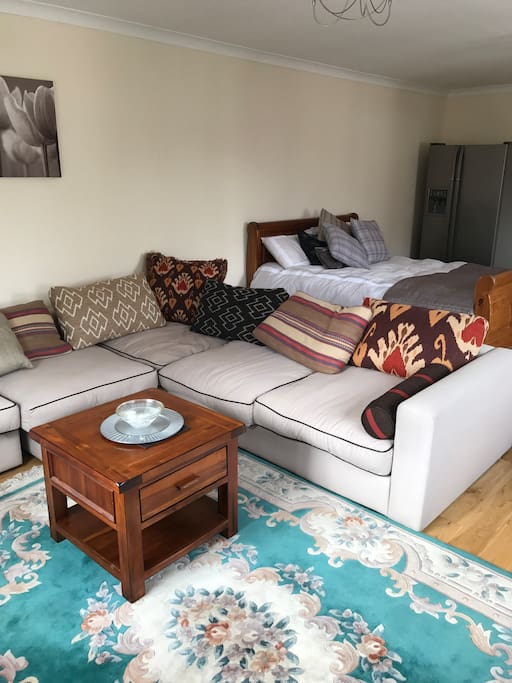 Spacious living area with corner couch
