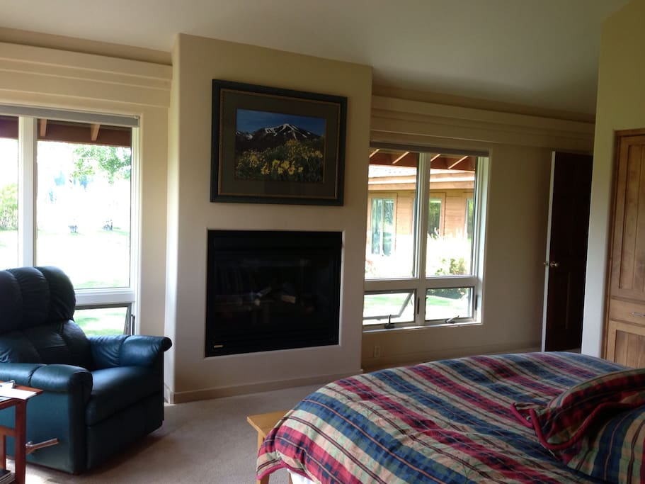 Master bedroom with gas fireplace and window to view of Baldy.