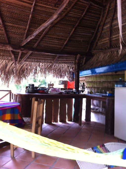 The kitchen has dishes, stove, all the necessary for cook.