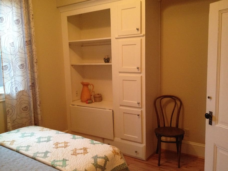 These built in cabinets are original to the house; this was the madam's office.