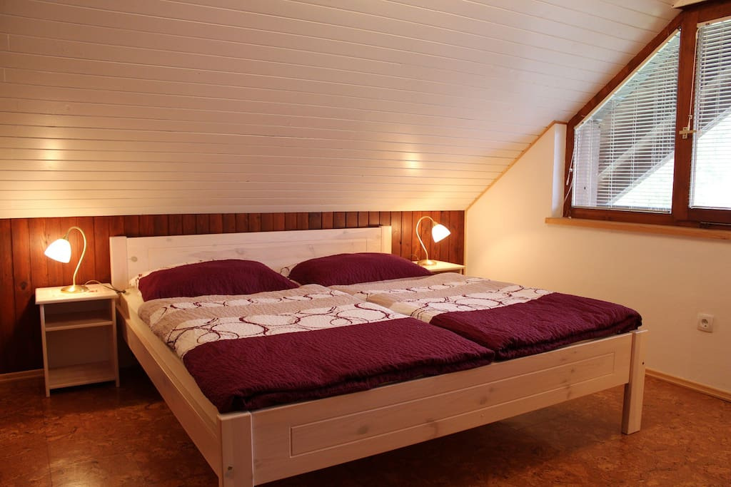 bedroom #1 with large double bed and single bed